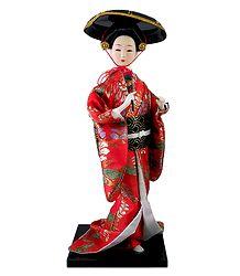 Geisha Doll in Red Kimono Dress Holding Fan