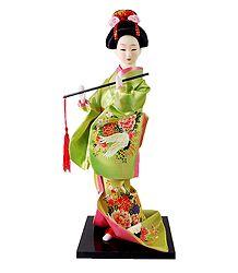 japanese Doll in Green Kimono Dress Holding Flute