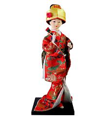 Japanese Doll in Red Kimono Dress Holding Fan