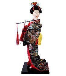 japanese Doll in Brocade Kimono Dress Holding Flute