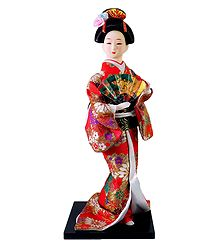 Japanese Doll in Red Kimono Dress Holding Flute