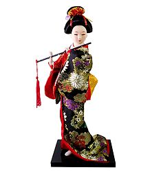 Japanese Doll in Multicolor Kimono Dress Holding Flute