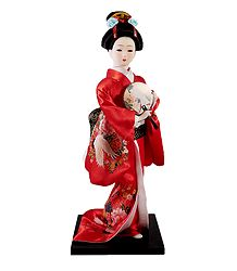 Japanese Geisha Doll in Red Kimono Dress Holding Fan