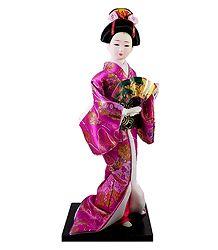 japanese Doll in Magenta Kimono Dress Holding Fan