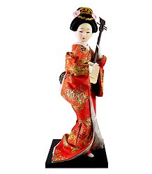 japanese Doll in Red Kimono Dress Playing Guitar