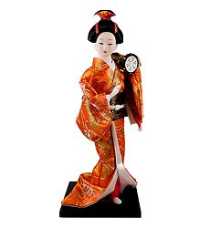 Japanese Geisha Doll in Saffron Kimono Dress Holding Drum