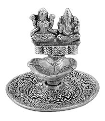 White Metal Oil Lamp with Ganesha and Lakshmi