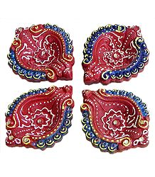 Set of Four Conch Shaped Maroon Terracotta Diya