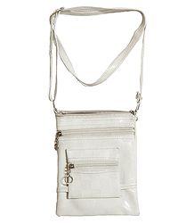 Cream Color Rexine Sling Bag with Four Zipped Pocket