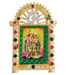 Radha Krishna on Stone Studded and Golden Carved Metal Frame - Table top Picture