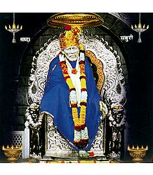 Shirdi Sai Baba in Blue Robe Sitting on Throne