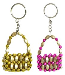 Key Rings with Golden and Magenta Plastic Bags