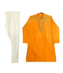 Embroidered Yellow Cotton Kurta and Cream Color Churidar