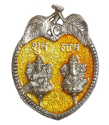 Lakshmi, Ganesha on Yellow Leaf - Metal Sculpture