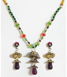 Black and Green Beaded Necklace with Stone Studded Pendant and Earrings