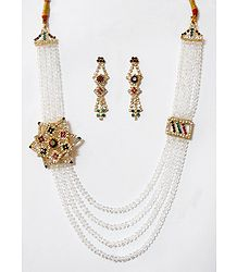 Four Layer White Crystal Necklace with Stone Studded Side Pendant and Earrings