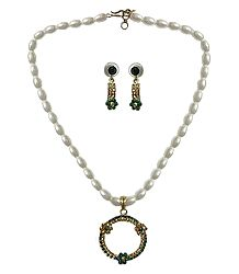 Synthetic White Bead Necklace with Green Stone Studded Pendant and Earrings