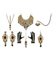 Faux Gemstones and Kundan Necklace Set with Shringar Patti, Jhumar, Mang Tika, Ring Bracelet and Nose Ring