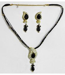Black Corded Necklace with White and Black Stone Studded Pendant and Earrings