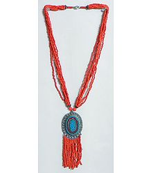 Dark Saffron Bead Necklace with Blue Beaded Metal Pendant