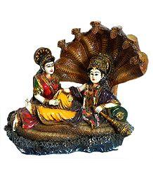 Vishnu Resting on Sheshanaga with Lakshmi - Resin Statue