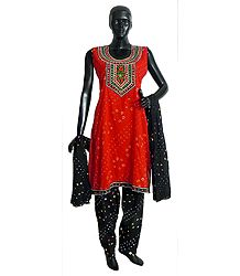 Saffron Tie and Dye Kurta with Mirrorwork and Embroidered Neckline with Black Tie and Dye Salwar and Chunni