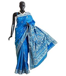 Cyan Blue Baluchari Silk Saree with All-Over Boota and Woven Wedding Scene on the Pallu and Border