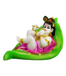 Krishna Resting on Leaf - Marble Dust Statue