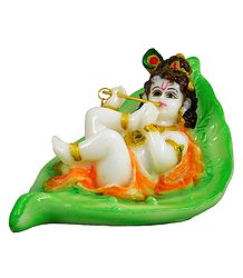 Krishna Resting on Leaf