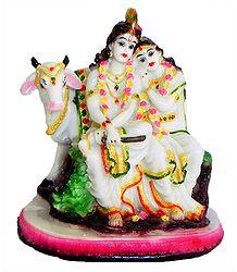 Radha Krishna Sitting with Cow