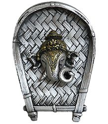 Terracotta Ganesha Face on a Silver Color Winnow