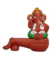 Ganesha Sitting on Veena - Terracotta Statue