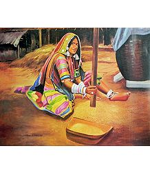 A Tribal Woman Grinding Grains