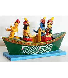 Nishad Raj Rowing Rama, Sita and Lakshmna to their Forest Abode - Kondapalli Dolls
