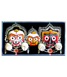 Jagannath, Balaram, Subhadra Face on Decorated Wooden Base - Wall Hanging