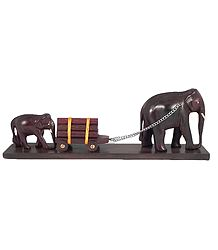 Two Elephants Carrying Logs